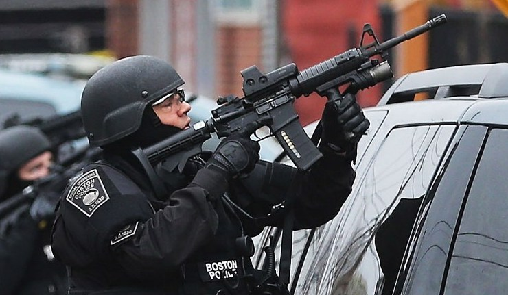 Boston SWAT team member takes up as posistion as they search for 19-year-old bombing suspect Dzhokhar A. Tsarnaev.