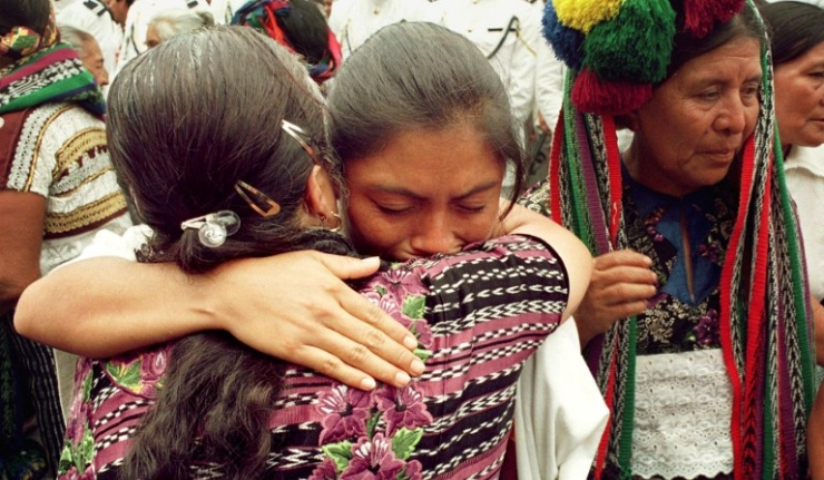 Mayan Indians mourn outside the Metropolitan Cathedral during the funeral of Bishop Juan Gerardi in Guatemala City, 29 April, 1998.